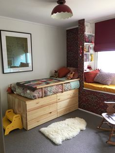 Finally! One of our own. Bed and window seat created by us using two sets of IKEA IVAR drawers.
