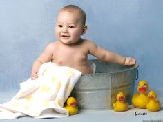 cute baby bathing with ducks Baby bathing tips: infant bath ...