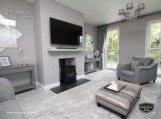 Grey lounge with grey sofas and grey carpet