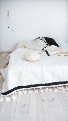 wool blanket with pom poms hand loomed in morocco