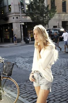 Le Fashion Blog -- Oversized button down and cut off shorts -- Anna Harrison of Russh Magazine -- New York Street Style via Free People Blog photo Le-Fashion-Blog-Cut-Off-Crazy-Button-Down-Denim-Shorts-New-York-Street-Style.jpg