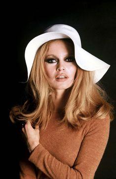 Brigitte Bardot wearing a wide-brimmed, floppy hat