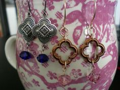 antiqued silver quatrefoil earrings with sapphire Swarovski rondelles. love the gold ones!