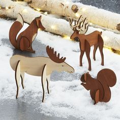 Shop Laser-Cut Animals, Set of 4: Deer, fox, moose and squirrel. Our dimensional deer, fox, moose and squirrel gather on the mantel or under the tree to create a charming woodland scene.