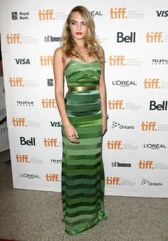 """Cara Delevingne wears a form-fitting green striped dress for the premiere of """"The Face of an Angel"""" to TIFF."""
