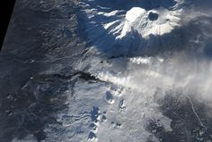 After more than a month of eruption, lava continues to flow from Tolbachik, one of many active volcanoes on Russia's Kamchatka Peninsula. The current eruption at Tolbachik began on Nov. 27, 2012. Lava flowed up to 20 kilometers (12 miles) from a line of fissures on the volcano's southern flank.