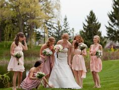 bridesmaids in a similar color scheme and in similar lengths...