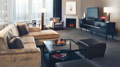 Relax by the fireplace in one of Trump Chicago's Deluxe Suites. http://www.trumphotelcollection.com/chicago/