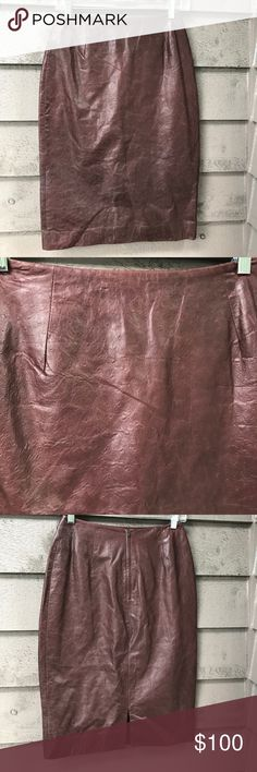Micheal Kors leather skirt 🎈🎈🎈🎈🎈 Micheal Kors brown leather skirt with ostrich look this skirt has never been worn . Michael Kors Skirts Midi