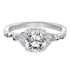 Diamond prong set halo engagement ring by ArtCarved Bridal.