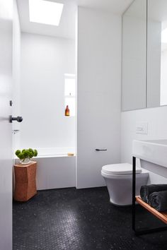 Boys Bathroom: large white wall tiles, black hexagon mosaic floor tiles, window in shower over bathtub, skylight, recessed built-in mirror cabinets Family Bathroom, Bathroom Wall Decor, Bathroom Flooring, Bathroom Interior, Modern Bathroom, Small Bathroom, Bathroom Black, Bathroom Ideas, Bathroom Designs