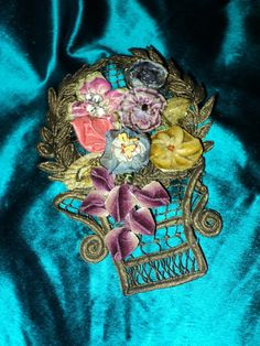 bottom of basket reminds me of  Dia de los Muertos skulls.. which gives me ideas.....;)..........................................Antique metallic ribbonwork