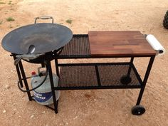 Disc cooker with double racks, paper towel holder, removable butcher block with rear wheels and handle to roll into your next cookout with style.