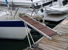 Wood panels on a ladder for a dog ramp to the sailboat ...