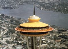 """Aerial view of the Space Needle and surrounding area in Seattle in 1962. The Century 21 Exposition, also called the Seattle World's Fair, was held from April 21, 1962, to October 21, 1962."""