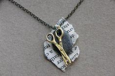 It's a rock-paper-scissors necklace! AH! SO CUTE!