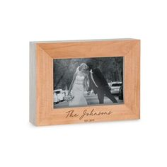Ebern Designs Show how much you care with this wooden picture frame, worthy of any photo memory. Made of natural wood edges, this beautiful frame will look equally at home in an office on your desk, family room, or even the baby's nursery. Add a custom engraved personalization online, such as your family name, to make this cute wooden photo frame a unique display, especially for a wedding photo. Inexpensive without looking cheap, these custom wooden picture frames make a small, affordable, gift Puzzle Picture Frame, Hanging Picture Frames, Picture Frame Sets, Wooden Picture Frames, Picture On Wood, Laser Engraved Gifts, Personalized Photo Frames, Valentines Day Pictures, Budget