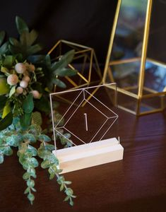These Two Wedding Trends Are a Match Made in Pinterest Heaven via Brit + Co See-Through Table Numbers:Ain't got time to DIY? No prob. Youcan always rely on Etsysellers to craft unique geo decor, like theseZCreateDesign Acrylic Table Numbers($9).