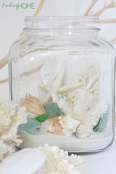 great ideas on how to make a beach terrarium. I didn't think about adding sea glass to my hurricanes like this.