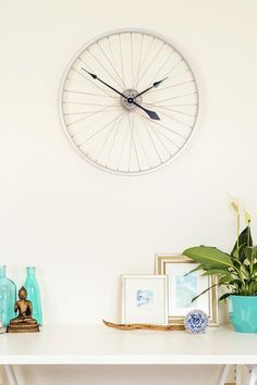 This Tread & Pedals Bicycle Wheel Clock is handcrafted from a recycled Bicycle wheel and set of cogs. The high quality clock mechanism is hidden well out of sight to give a super sleek finish. The movement is Quartz (high torque, reliable and quiet movement) It takes one AA cell battery and comes with hanging hardware and mounting instructions. This clock has been scrubbed clean and polished but remember it's made from a recycled product so it will come with its own character and charm. Due…