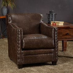 This nailhead trim club chair has a hardwood frame with plush upholstery and features sturdy coffee brown finish legs. This overstuffed sofa chair offers firm, comfortable seating that is perfect for any home decor with its brown color.