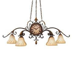 Six-light chandelier of iron in Warm Antique Gold finish. Features unique double-sided working clock. Gold dusted hand-blown glass shades.