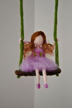 This is a Waldorf inspired piece made of wool by the needle-felting technique. Its been created to provide a peaceful and harmonious image that communicates with the soul through its colors, textures, forms and energy. Dimensions: 8 in x 4in. Doll: 5 in SHIPPING: Since shop-home is