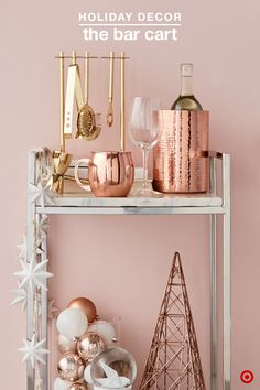 Celebrate in style by having everything you need for holiday entertaining. A bar cart that is well-stocked, organized and deigned to shine is key. Add a festive touch by layering useful hosting must-haves, like barware in golds and coppers mixed with glitzy holiday decor. TIP: Update the look each season by switching out the d_cor, taking it from Christmas to New Years to ValentineÍs Day with ease.