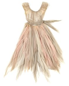 A pastel chiffon rag dress worn by Leslie Caron in the Cinderella tale The Glass Slipper (MGM, 1955). The costume has a fitted boned bodice and an intentionally tattered skirt formed from layers of torn chiffon in pale grey and pink. Additionally, there are two pairs of dance pants with attached strips of sheer grey fabric.  Costume design by Walter Plunkett and Helen Rose.