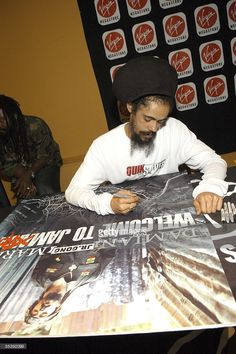 Recording artist, Damian 'Jr. Gong' Marley, signs memoribilla at his album release performance and signing at Virgin Megastore September 12, 2005 in New York City.