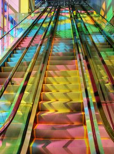 Colorful escalator in Palais des Congrès,  Montréal, Canada - photography by wemidji, Via Flickr