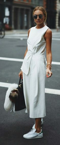 Work culottes into an all white outfit by matching them with a tie-front shirt and sneakers. Via Nina Suess Shops: Not Specified
