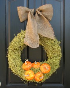 Love the big burlap ribbon - and just about any seasonal ornament can be pinned or glued to this wreath