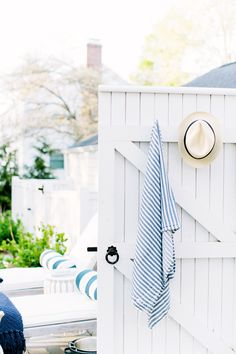 Backyard scene with towel and hat