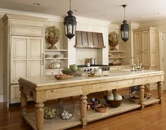 Farmhouse style kitchen island in this cream kitchen by Hickman Design Associates.