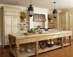 Farmhouse style kitchen island in this cream kitchen by Hickman Design Associates.