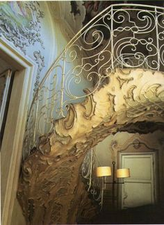 The staircase decorated with stucco, which leads to the bandstand in the ballroom. Biscari Palace, Catania.