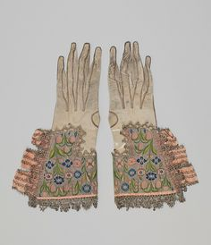 Pair of gloves  Date: early 17th century Culture: British Medium: Leather, silk and metal thread Accession Number: 28.220.1, .2