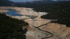 The Enterprise Bridge passes over a section of Lake Oroville that is nearly dry on August 19, 2014 in Oroville, California
