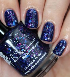 """KBShimmer Hex Appeal   """"Hex Appeal"""" has blue, silver and magenta holo hexes and some teeny microbars in a navy blue jelly base.  This one is also a favorite of mine (who am I kidding, they are all my favorite!)  The blue base and the mix of glitter is absolute perfection.  This is 2 coats over China Glaze """"Man Hunt."""""""