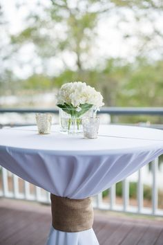 Cocktail tables with white linens, white hydrangeas, and votives. We love the rustic and nautical touch of the burlap ribbon {Alyona Photography} (wedding reception table decorations hydrangeas) Cocktail Wedding Reception, Wedding Reception Table Decorations, Wedding Table Linens, Cocktail Table Decor, Cocktail Tables, Nautical Wedding, Rustic Wedding, Wedding Ideas, Wedding Details