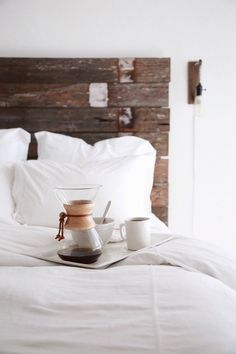 wood headboard and white sheets.
