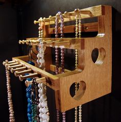 Necklace Holder Storage Hanging   18 inches with 2 inch pegs. $31.00, via Etsy.