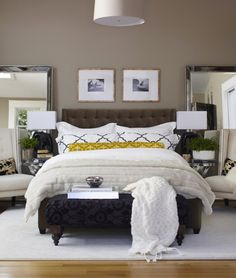 Gorgeous room, mirrors flanking the bed