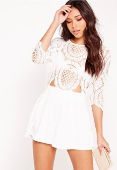 Send out those sweetheart vibes and play up your feminine side in this pretty white crochet playsuit. Featuring lace detailing, a gold back zip and a waist cut out, you'll be looking insane on the dance floor. Team with black heels and a cl...