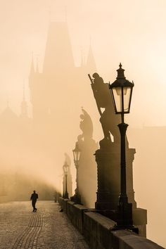 Early morning on the Karls Bridge in Prague, Czech Republic.
