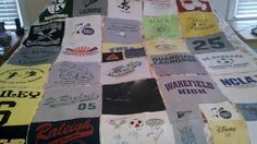 High school graduation T-shirt quilt in progress. 30 t-shirts cut in to 12 inch squares