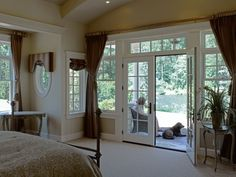 Cornice and shade over oval window and drapery over the other windows.