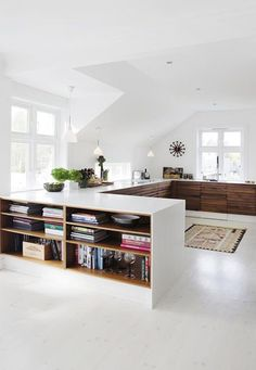 white and wood low bookcases / sfgirlbybay