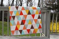 I like the shape of these triangles. Do with the black, grey, white and yellow color scheme though?